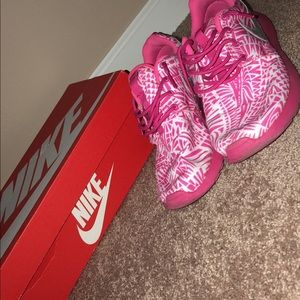 Pink and white Nike Roshe sneakers